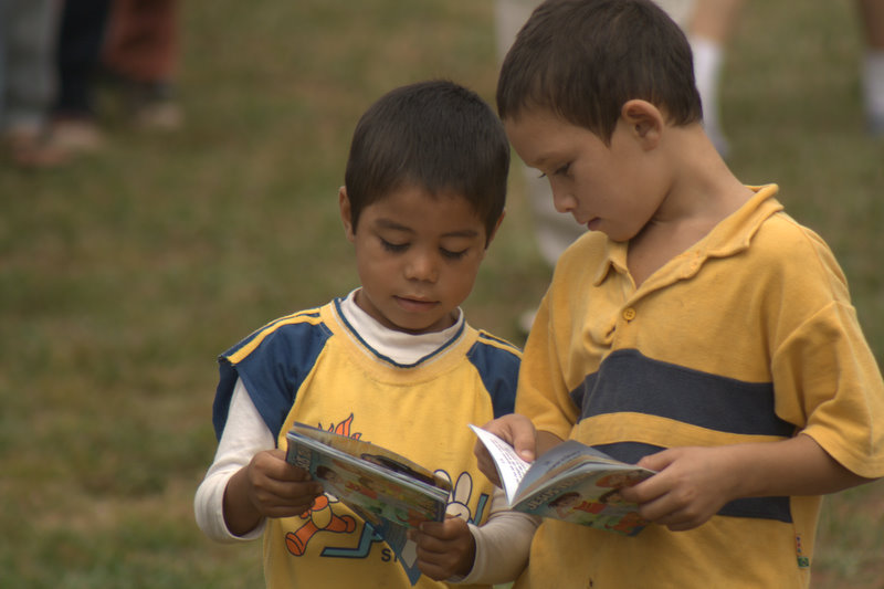 Boys reading a booklet